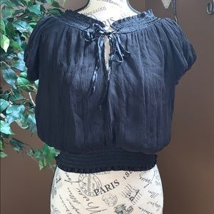 Cropped sheer blouse. Can wear off the shoulders